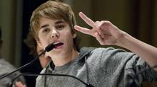 "Justin Bieber gestures during a press conference in Toronto to plug his new documentary ""Never Say Never."" (Darren Calabrese/CP)"