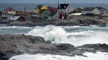Waves pound the shore in Peggy's Cove, N.S. on Sunday, Dec.30, 2012 as a winter storm passed through the region. Rain, snow and high winds disrupted transportation and knocked out power in some communities. (Andrew Vaughan/THE CANADIAN PRESS)