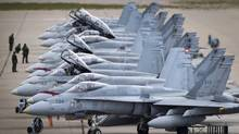 CF-18's line up on the tarmac at CFB Cold Lake, Alta., Sept. 28, 2010 (JOHN LEHMANN/The Globe and Mail)