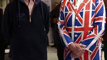 The Governor of the Falkland Islanders and an enthusiastic voter in the March 11 referendum. (MARCOS BRINDICCI/REUTERS)