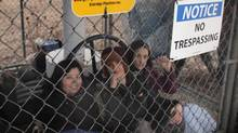 Enbridge says its Line 9 pipeline was offline for about 90 minutes after three activists locked themselves to a valve site east of Sarnia, Ont., on Dec. 21. (HO/THE CANADIAN PRESS)
