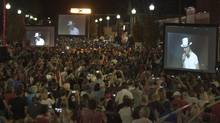 Fans gather on Bolton Street in Bobcaygeon Ontario to watch The Tragically Hip's final concert on video screens in Kingston on Saturday August 20, 2016. (Fred Thornhill/THE CANADIAN PRESS)