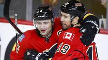 Calgary Flames' David Jones, right, celebrates his goal with nteammate Mark Giordano during second period NHL hockey action against the Tampa Bay Lightning in Calgary on Tuesday, Jan. 5, 2016. (Jeff McIntosh/THE CANADIAN PRESS)