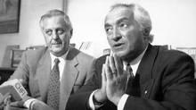 Avie Bennett, left, listens to Mel Hurtig speak at a news conference in Toronto in May, 1991. (John Felstead/THE CANADIAN PRESS)