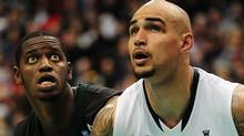 Hawaii Warriors centre Vander Joaquim (15) and Gonzaga Bulldogs centre Robert Sacre (00) watch a shot during the second half at Rogers Arena. The Gonzaga Bulldogs won 73-54. Anne-Marie Sorvin-US PRESSWIRE (Anne-Marie Sorvin/US PRESSWIRE)
