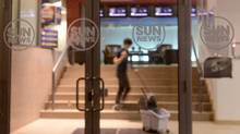 A cleaner mops the steps in the lobby of the Sun News Network building in Toronto on Thursday Feb. 12, 2015. The Sun News Network is shutting down Friday morning after negotiations to sell the troubled television network were unsuccessful. (Doug Ives/THE CANADIAN PRESS)