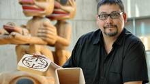 SFU Archaeology instructor Rudy Reimer holds a small replica of the handmade bentwood boxes that will be used to store ancestral Aboriginal remains. (Handout/Handout)