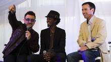 U2 frontman Bono, left, Somali-Canadian hip-hop artist K'naan, centre, and Globe and Mail's Editor-in-Chief John Stackhouse talk about the famine in Somalia in Toronto on Sept. 10, 2011. (Michelle Siu/The Globe and Mail)