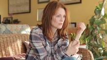 Julianne Moore plays a mother of three who tries to present a good front while struggling with early-onset Alzheimer's disease in Still Alice. (Linda Kallerus/Sony Pictures Classics)