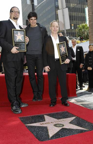 Magicians Penn (left) and Teller (right), seen here last week on the Walk of Fame in Hollywood with David Copperfield, are about to attempt their most difficult but rewarding magic trick ever. (Mario Anzuoni/Reuters)