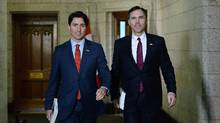 Minister of Finance Bill Morneau, right, is accompanied by Prime Minister Justin Trudeau as he makes his way to deliver the federal budget in the House of Commons on Parliament Hill in Ottawa on Tuesday, March 22, 2016. (Sean Kilpatrick/THE CANADIAN PRESS)