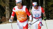 Canadian Brian Mckeever, rear, and guide Graham Nishikawa compete in the cross country mens 20km Visually impaired event at the Sochi 2014 Paralympic Winter Games (Scott Grant)