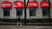 A man walks by a Rogers retail store before the Rogers Communications Inc annual general meeting for shareholders in Toronto April 22, 2014. (MARK BLINCH/REUTERS)