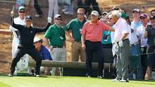 Gary Player, left, reacts to almost making a hole in one, while Jack Nicklaus, centre, and Arnold Palmer look on during the Par 3 Contest at Augusta National on Wednesday, April 9, 2014. (Curtis Compton/AP)