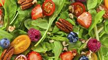 Toss some berries into a green salad to get boost your intake of fibre.