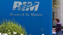 The Research In Motion Ltd. company logo in front of one of their many buildings, in Waterloo, Ont. (DAVE CHIDLEY/THE CANADIAN PRESS)