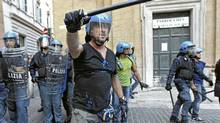 Italian police clash with anti-austerity protesters Sept. 14, 2011, in Rome. Reuters