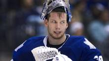Toronto Maple Leafs goalie James Reimer looks determined as third period winds down against the Buffalo Sabres in their NHL hockey game in Toronto March 12, 2011. REUTERS/Fred Thornhill (FRED THORNHILL)