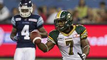 Edmonton Eskimos' Hugh Charles (right) celebrates scoring a touchdown as Toronto Argonauts' Pacino Horne looks on during second half CFL action in Toronto on Monday August 27 , 2012. Charles and the Eskimos face the Argonauts in Sunday's CFL East semi-final. (Chris Young/THE CANADIAN PRESS)