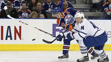 Edmonton Oilers Forward Jordan Eberle gets a shot away in front of Toronto Maple Leafs defenceman Morgan Rielly at Rexall Place. (Perry Nelson/USA Today Sports)
