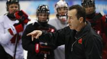 Kevin Dineen, coach of Canada's women's hockey team, 'jumped right in immediately' when given the job, embarking on a crash course of sorts in the women's game. (MARK BLINCH/REUTERS)