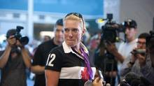Olympic Silver medalist and Canadian women's eight rowing crew member, Krista Guloien, tears up as fans sign the Canada's National anthem after arriving at Vancouver International Airport in Richmond, British Columbia, Monday, August 13, 2012. (Rafal Gerszak For The Globe and Mail)