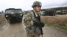 A U.S. Marine soldier conducts the U.S.-South Korea joint Exercise Operation Pacific Reach in Pohang, South Korea, Tuesday, April 11, 2017. North Korea is vowing tough counteraction to any military moves that might follow the U.S. move to send the USS Carl Vinson aircraft carrier and its battle group to waters off the Korean Peninsula. (Ahn Young-joon/AP)