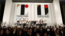 The 2020 Olympics being held in Tokyo has placed a premium on properties with views or near famous landmarks. Here, officials and athletes wave as the organizing committee unveils Tokyo 2020 emblems in July. (ISSEI KATO/REUTERS)