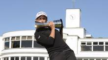 Mo Martin of the U.S. poses for photographs after winning the women's British Open golf tournament at the Royal Birkdale Golf Club in Southport, northern England, July 13, 2014. (NIGEL RODDIS/REUTERS)