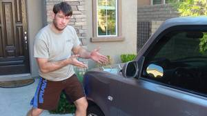 UFC fighter Forrest Griffin with his 2005 Scion xB.