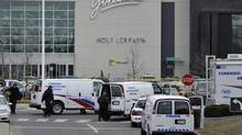 Toronto Police search for evidence in the west parking lot at Yorkdale Mall on Sunday morning following a fatal shooting Saturday night, in Toronto, March 31, 2013. (J.P. Moczulski for The Globe and Mail)
