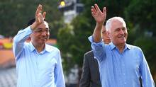 Australia's Prime Minister Malcolm Turnbull waves with China's Premier Li Keqiang as they walk along the Sydney Harbour foreshore in Sydney on March 25, 2017. (DAVID GRAY/AFP/Getty Images)