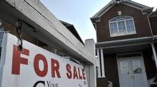 A for sale sign sits in front of a Mississauga residential home in this file photo. (J.P. MOCZULSKI For The Globe and Mail)