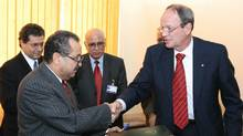 Shukri Ghanem, left, chairman of Libya's National Oil Corp., shakes hands with Ron Brenneman, chief executive officer of PetroCanada, during a December 2007 meeting in Tripoli. (Mahmud Turkia/AFP/Getty Images/Mahmud Turkia/AFP/Getty Images)