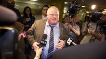 Toronto Mayor Rob Ford walks from his office to the elevator on his way back to the afternoon council meeting at City Hall in Toronto. (Peter Power/The Globe and Mail)