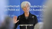 International Monetary Fund Managing Director Christine Lagarde delivers a speech Monday in Berlin. (Jens Meyer/Jens Meyer/Associated Press)