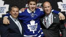 Frederik Gauthier poses with team executives in a Toronto Maple Leafs jersey after being selected by the Leafs as the 21st overall pick in the 2013 National Hockey league (NHL) draft in Newark, New Jersey, June 30, 2013. (BRENDAN MCDERMID/REUTERS)