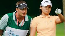 Yani Tseng of Taiwan lines up her tee shot on the 16th hole with her caddie Jason Hamilton during the third round of the Wegmans LPGA Championship at Locust Hill Country Club on June 25, 2011 in Pittsford, New York. (Photo by Scott Halleran/Getty Images) (Scott Halleran/Getty Images)