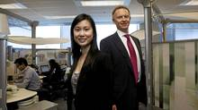 Consultant Bonnie Kwan and President and Managing Director for Accenture in Canada Bill Morris pose for a photo in their office in Mississauga, Ont. (Michelle Siu For The Globe and Mail)