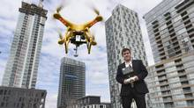 May 2 2014, Matthew Slutsky, with buzzbuzzhome.com demonstrates the drone that he uses to take photos and video of condominiums that are being built. His four bladed drone can stay aloft for roughly 30 minutes depending on wind conditions. (Fred Lum/Fred Lum/The Globe and Mail)