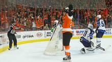 Claude Giroux #28 of the Philadelphia Flyers celebrates his game winning goal at 4:46 of overtime against Ondrej Pavelec #31 of the Winnipeg Jets at the Wells Fargo Center on March 28, 2016 in Philadelphia, Pennsylvania. The Flyers defeated the Jets 3-2 in overtime. (Bruce Bennett/Getty Images)