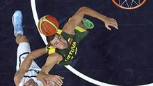 Lithuania's Jonas Valanciunas reaches for a rebound during his men's Group A basketball match at the London 2012 Olympic Games in the Basketball arena July 29, 2012. (SERGIO PEREZ/REUTERS)