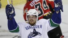 Vancouver Canucks forward Daniel Sedin celebrates a goal last season. (TODD KOROL)