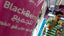 A sign advertising the BlackBerry mobile phone is seen at a shopping mall in Dubai on August 01, 2010, as the Gulf business hub stated it will suspend key BlackBerry services from October because they are incompatible with local laws and raise security concerns. (-/AFP/Getty Images)