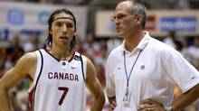 Canadian head coach Jay Triano and guard Steve Nash talk during a timeout against Puerto Rico in the first half of the final round at the 2003 FIBA Americas Men's Olympic Qaulifying Tournament in San Juan, Puerto Rico, August 31, 2003. (LUCY NICHOLSON/Reuters)