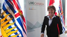 British Columbia Premier Christy Clark leaves after announcing an agreement with Shell Canada Energy, PetroChina Corporation, Korea Gas Corporation and Mitsubishi Corporation to develop a proposed liquefied natural gas (LNG) export project, in Vancouver, B.C., on Wednesday April 30, 2014. The proposed project is to be located in Kitimat, B.C. (DARRYL DYCK/THE CANADIAN PRESS)