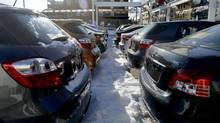 File photos of cars for sale on the lot at the Toyota dealership in Toronto. (Fred Lum/Fred Lum/The Globe and Mail)