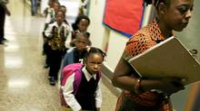 Grade one teacher Nadia Hohn escorts her students to class at The Afrocentric alternative school opened in Toronto, Ontario on September 8, 2009 (Jim Ross/Jim Ross for the Globe and Mail)