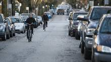 Cyclists ride along the West 10th Avenue bike corridor near Yukon Street in Vancouver on Dec. 24, 2016. (Rafal Gerszak/The Globe and Mail)