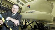 Marc Parent, president and CEO of CAE Inc., poses in front of a flight simulator 737 destined for Malaysia, in Montreal. (Christinne Muschi For The Globe and Mail)